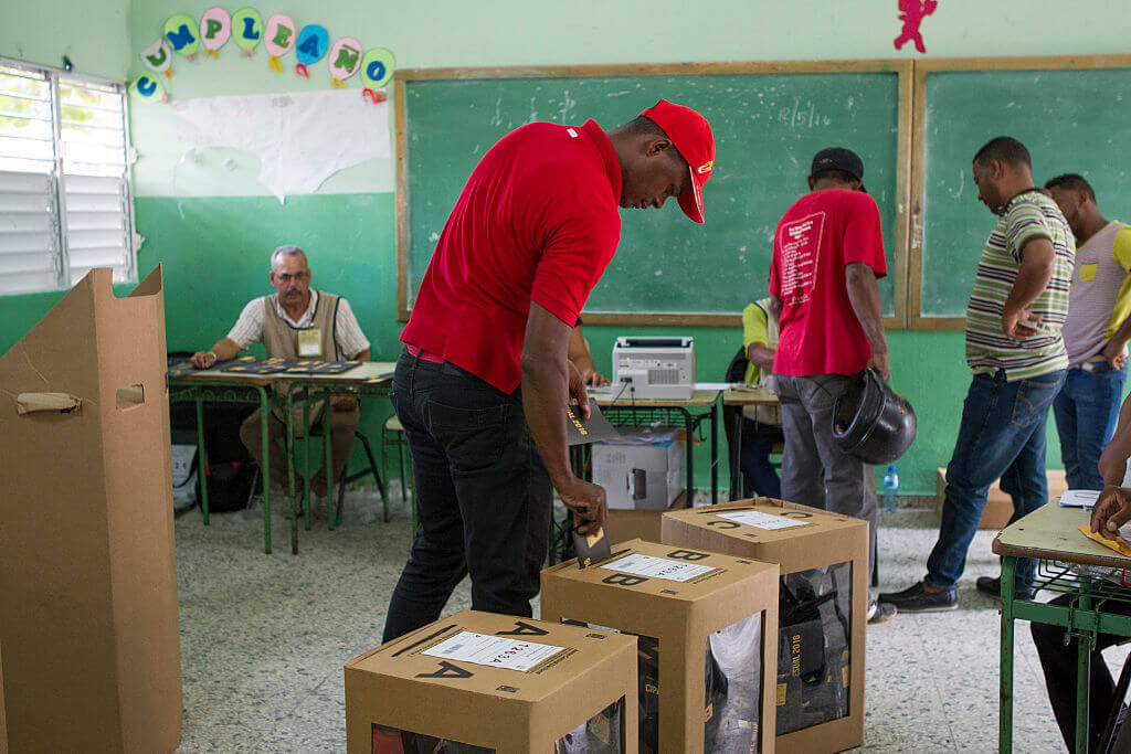 A man casts his vote at a polling station in Santo Domingo during general elections on May 15, 2016.  Voting began Sunday in the Dominican Republic's presidential election, where incumbent leader Danilo Medina is tipped to win despite grinding poverty and widespread crime. / AFP / afp / ERIKA SANTELICES        (Photo credit should read ERIKA SANTELICES/AFP via Getty Images)