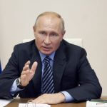 FILE  In this file photo taken on Thursday, July  9, 2020, Russian President Vladimir Putin gestures during a video conference meeting at the Novo-Ogaryovo residence outside Moscow in Moscow, Russia. Putin says that a coronavirus vaccine developed in the country has been registered for use and one of his daughters has already been inoculated. Speaking at a government meeting Tuesday, Putin said that the vaccine has proven efficient during tests, offering a lasting immunity from the coronavirus. (Alexei Druzhinin, Sputnik, Kremlin Pool Photo via AP, File)