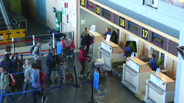 depositphotos_109346050-stock-video-airline-passengers-checking-in-at